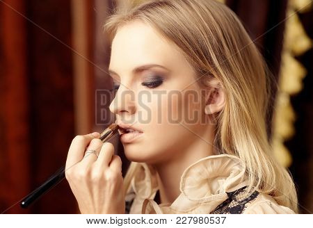 Woman Face With Make Up. Close-up Portrait