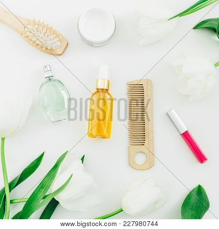 Cosmetics, Perfume, Hair Styling Tools And Tulips Flowers On White Background. Beauty Blog. Flat Lay