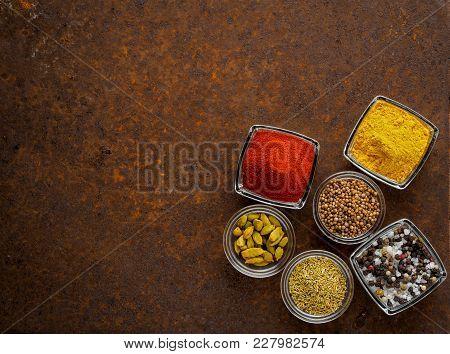 Mix Spices On A Dark Brown Rusty Metal Table - Coriander Seeds, Ground Red Pepper, Salt, Black Peppe