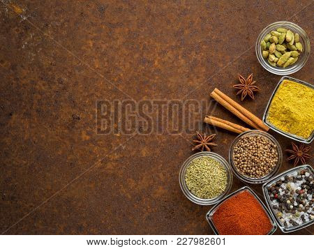 Set Of Various Spices On A Dark Brown Rusty Metal Table - Coriander Seeds, Ground Red Pepper, Salt,