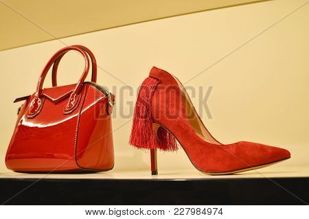 Red Women's Bag In A Combination Of Red Stilettos. The Concept Of Style And Taste