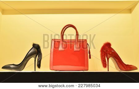 Red Women's Bag In A Combination Of Red And Black Stilettos. The Concept Of Style And Taste