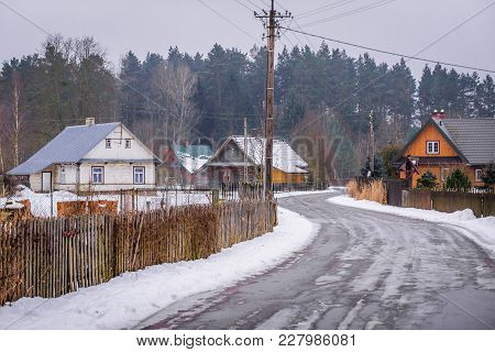 Main Road Of Gruszki Village On The Edge Of Bialowieza Forest In Poland