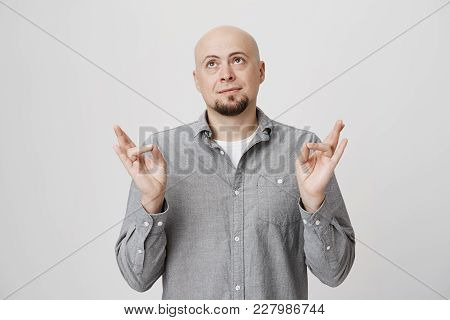 Bald Caucasian Businessmen With Beard Wearing Trendy Shirt Over White T-shirt Looking Thoughtfully U