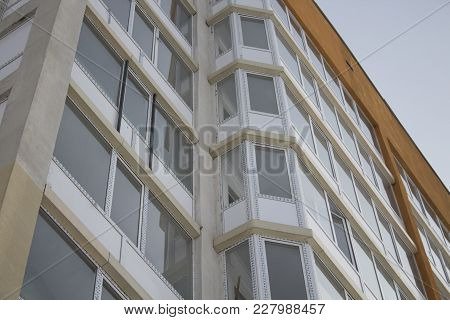Apartment building. Multistory building. New building.Social architecture. Contemporary architecture. Apartment block. Housing estate. Residential neighborhood.