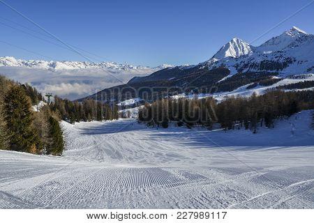 Perfectly Groomed Empty Ski Piste In Pila, Valle D'aosta, Italy