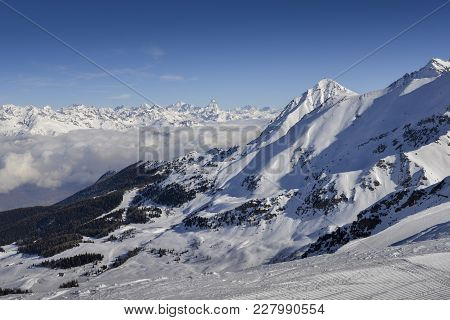 Panoramic View Of Wide And Groomed Ski Piste In Resort Of Pila In Valle D'aosta, Italy During Winter