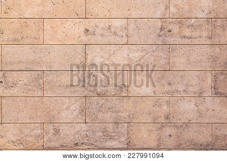 Texture Of A Stone Porous Wall, Polished With A Brick Pattern. Background For Design.
