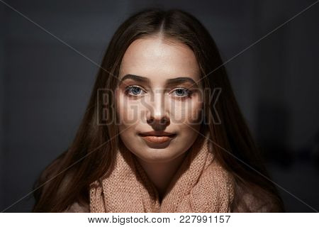 Close-up Portrait Of Beautiful Girl In Studio On Black Background.