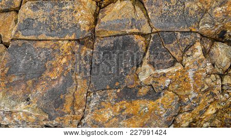 Abstract Background Of Stone Wall Texture. Cracked Stone Texture Background. Old Stone