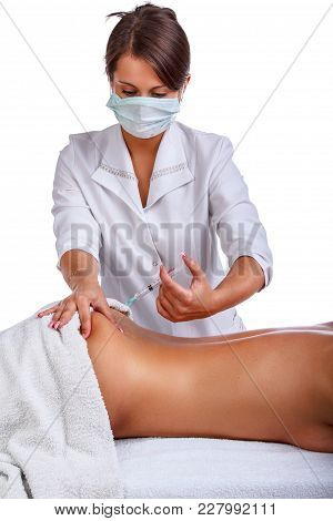 Syringe Injection In To Woman's Back.