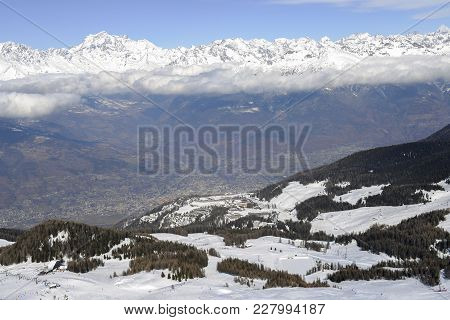 Aerial View Of Northern Italian City Of Aosta And Surrounding Valle D'aosta From Pila Ski Resort