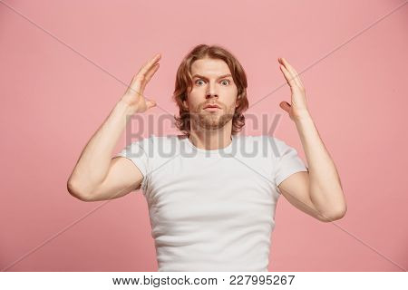 Wow. Beautiful Male Half-length Portrait Isolated On Pink Studio Backgroud. Young Surprised Man Hold