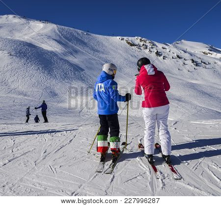 Pila, Aosta, Italy - Feb 19, 2018: Female Skier With A Jacket Written Ita Which Is Short For Italy A