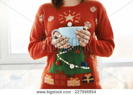 Christmas Mood Is In Air. Cropped Shot Of Woman At Home, Wearing Funny Christmas Sweater With Tree,