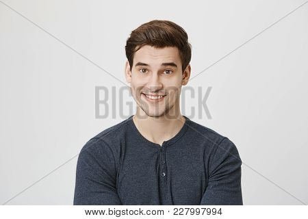Waist-up Portrait Of Caucasian Handsome Attractive Young Male Model With Dark Hair Andstubble Dresse