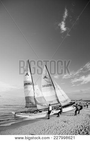 Gdansk, Poland - September 19, 2016: Windsurfer Or Man Sportsman Surfs And Sails On Board By Wind On
