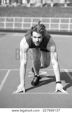 Start. Concentrated Runner, Athletic Bearded Man With Muscular Body Start On Running Track Sunny Out