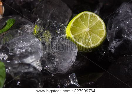 Lemon And Ice Cubes On A Black Background
