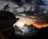 silhouette of a biker in the Swiss Alps poster