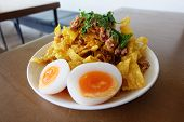 Fried wontons with boiled egg and spicy sauce. poster