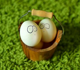 Funny Easter Eggs On A Green Grass.