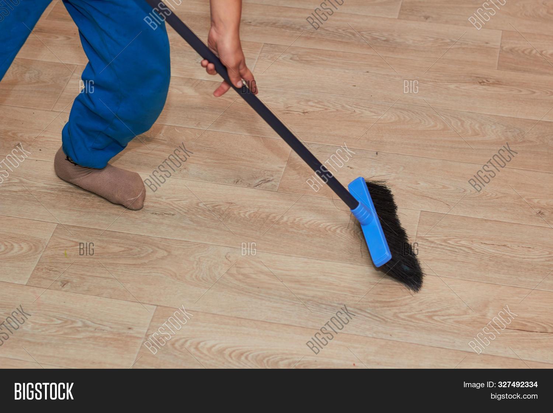 sweep floor broom feet image photo free trial bigstock bigstock