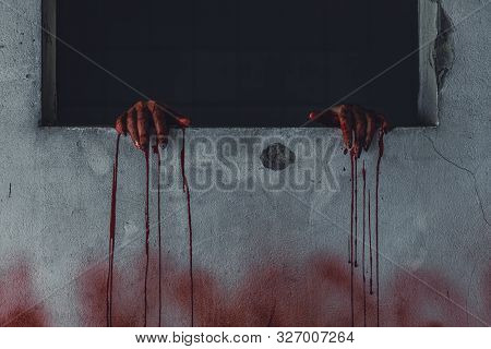Horror Scence Of Woman With Scary Hand  At Abandoned House. Hand Through The Hole Wall. Halloween Co