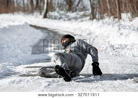 Injured Man Lying On The Road, Downfall And Accident On Winter Season, Black Ice