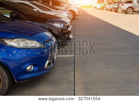 Cars Parked At The Parking Lot,car A Lot Parking And Sunset,transportation And Technology Concept.