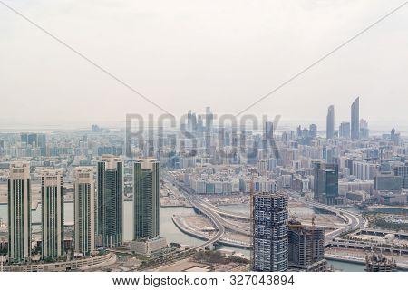 Dramatic Aerial Shot Of A Modern City - Abu Dhabi Skyline And Skyscrapers And Al Reem Island - Uae C