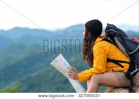 Asian Women Hiker Or Traveler With Backpack Adventure Holding Map To Find Directions And Sitting Rel