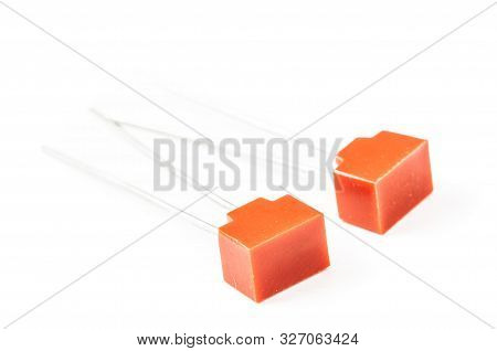 Various Electronic Components, Suppression Capacitor Close-up Series On White Background.