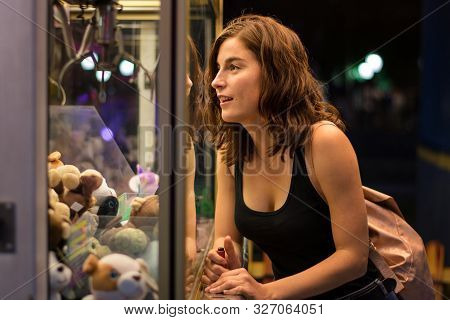 Young Woman Is Playing A Game In A Fair