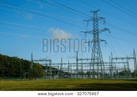 Iron Utility Pole Of A High Voltage Power Line And Distribution Unit.