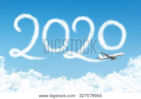 Happy New Year 2020 Concept Travel On The Background Below Cloudscape. Drawing By Passenger Airplane