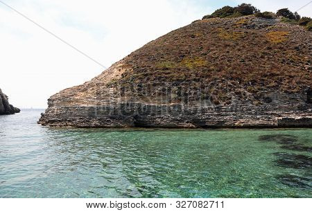 Clear Water Of The Mediterranean Sea And A Small Island In Summer
