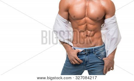 Close Up Pic Of A Male Shirtless Torso With Perfect Abs. Sexy Man It Blue Jeans And White Shirt Over