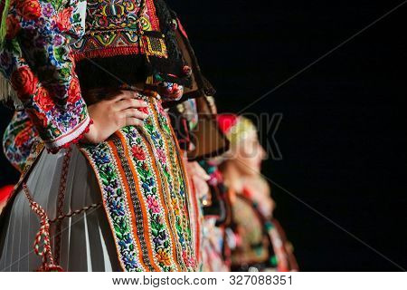 Close Up On Detail Of Young Romanian Female Dancer Traditional Folkloric Costume. Folklore Of Romani