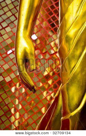 A Hand Of Golden Buddha Statue