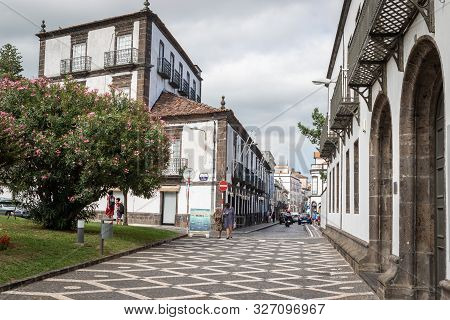 Ponta Delgada, Azores, Portugal - August 14, 2019: Pedestrian Zone, Park And Typical Houses On A Sho