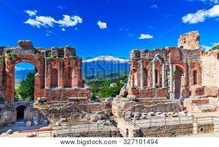 Taormina, Sicily, Italy: The Greek Theater Of Taormina With Smoking Etna Volcano In Background