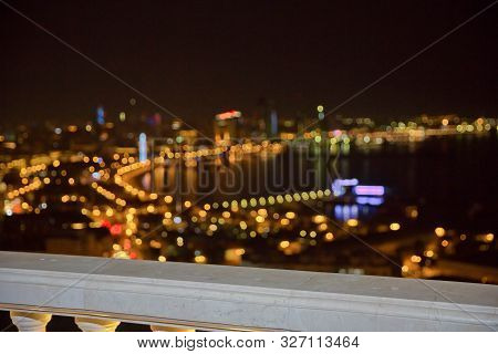 Abstract Background Of City Lights Bokeh. Blurred City Lights . Defocused Blurred Lights Of Baku Cit