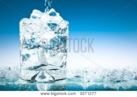 Cool Blue Iced Glass With Pouring Water