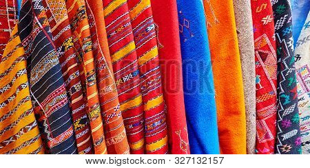 Colorful Fabrics And Carpets For Sale On A Street In Medina Of Chefchaouen, Morocco, Small Town In N