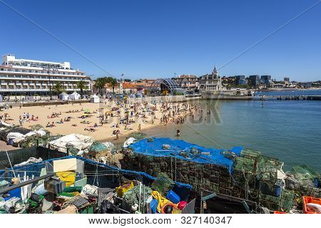 Cascais - August 14, 2019: View Of The Crowded Pretty Little Beach Named Praia Do Pescador Along The