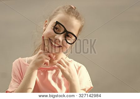 Perfect Props For Partying. Happy Little Child Looking Through Glasses Props. Funny Small Girl Weari
