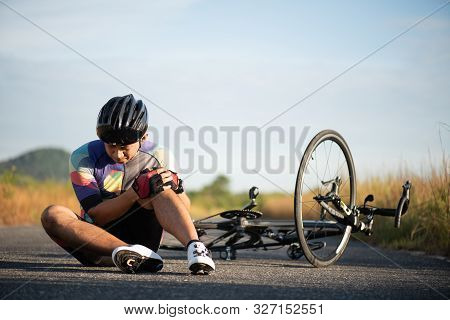 Bike Injuries. Man Cyclist Fell Fell Off Road Bike While Cycling. Bicycle Accident, Injured Knee.