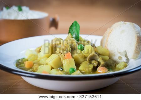 Cau Cau Potato Peruvian Recipe With Chiken Or Cow Meal. Rice