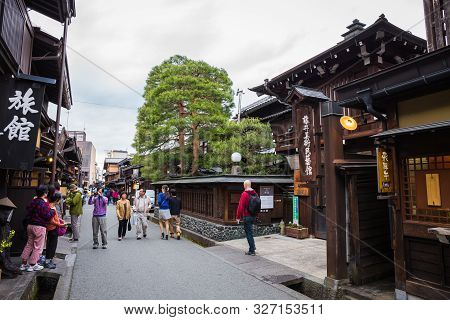 Takayama, Japan - May 9, 2015: Tourists Visit The Old Town In Takayama. Is A Famous And Popular Plac